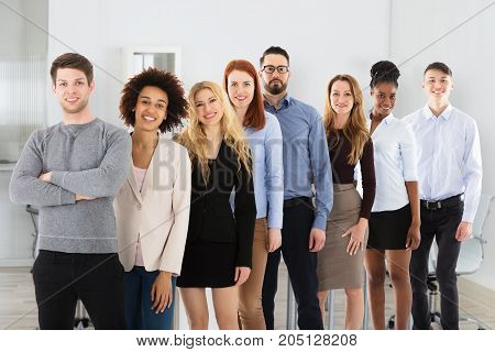 Confident Smiling Young Multi Ethnic Business People In Office