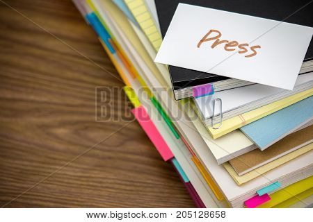 Press; The Pile Of Business Documents On The Desk