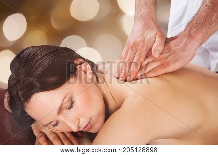 Close-up Of A Woman Getting Back Massage By Male Therapist In Spa
