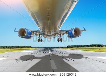 Passenger Close Up Bottom Airplane Fly Over The Runway In Good Weather