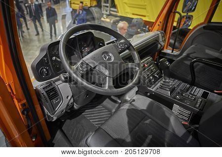MOSCOW, SEP, 5, 2017: View on new service truck Mercedes-Benz Unimog cabin interior.  Commercial Transport Exhibition ComTrans-2017. Mercedes Benz car cabin saloon. Service truck cabin interior