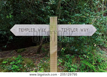 Dartmoor, Devon, UK, May 9, 2017. Editorial photograph of wooden route sign near Bovey Tracey on the edge of Dartmoor, showing the route of the Templer Way, a walking trail that follows an old granite tramway.