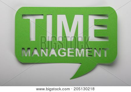 Elevated View Of Green Time Management Text Over White Background