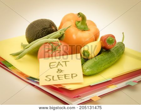 Office Documents And Vegetables; Eat And Sleep