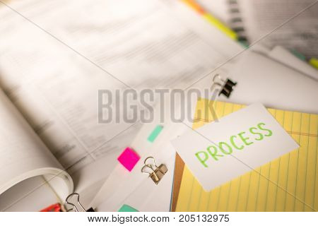 Process; Stack Of Documents With Large Amount Of Analytic Material.