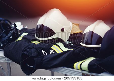 Clothes form for the fire brigade Fireman: helmet. Protection from fire.