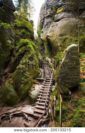 Steps in Unique rocks mountain Adrspasske skaly in national park Adrspach in Czech republic