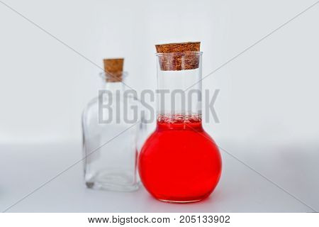 test tube flasks with health points a red liquid, on a white background.