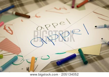 English; Kids Writing Name Of The Fruits For Practice