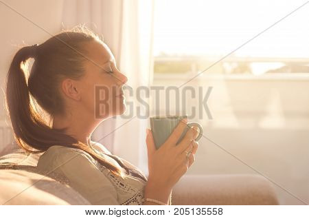 Girl Smelling Coffee On Sunshine