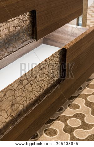 Close up open drawers on modern commode
