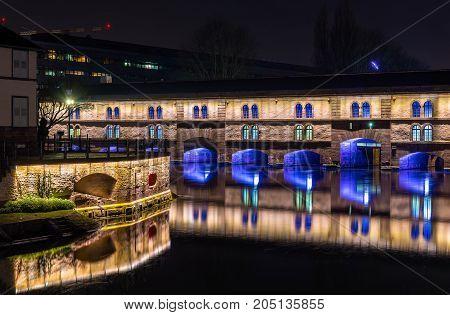 Night illumination of Barrage Vauban or Vauban weir in Strasbourg, France