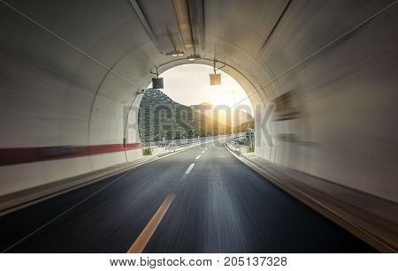 Tunnel through the mountain on the highway.