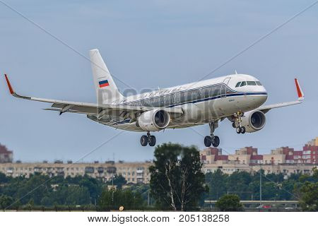 Pulkovo, Saint-Petersburg, Russia - August 10, 2017:   The airplane  Airbus A320 of Aeroflot  airlines is landing on the runway against the background of the city skyline. Has a special livery - dobrolet