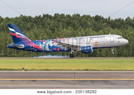 Pulkovo, Saint-Petersburg, Russia - August 10, 2017:   The airplane  Airbus A320 of Aeroflot  airlines is landing on the runway. Has a special livery - PFC CSKA