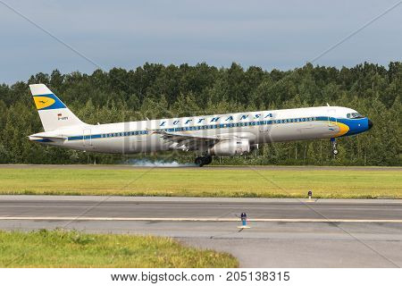 Pulkovo, Saint-Petersburg, Russia - August 10, 2017:   The airplane  Airbus A321 of Aeroflot  airlines is landing on the runway. Has a special retro livery