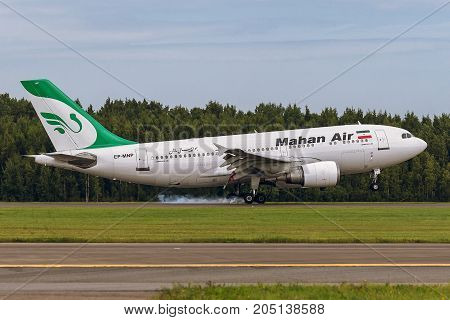 Pulkovo, Saint-Petersburg, Russia - August 10, 2017:   The airplane Airbus A310 of Mahan Air is landing on the runway against the background of the forest
