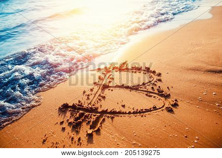 Bitcoin. Image of icon bitcoin on golden sand, in background sea sun light. Concept freelance, stock exchange