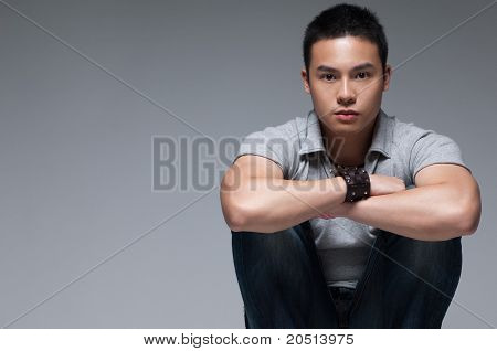 Asian Guy Sitting Down