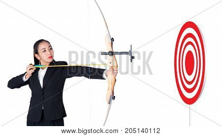 Businesswoman holding bow and shooting to archery target with target success concept.