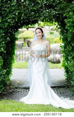 beautiful young woman on wedding day in white dress in the garden - Female portrait in the park - Selective focus.