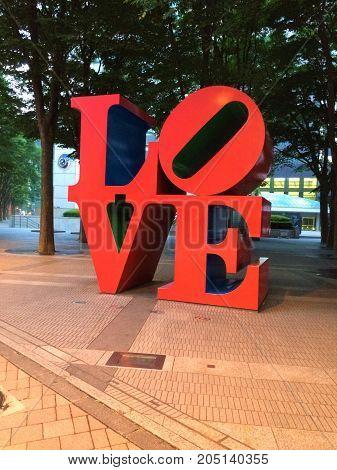 love sign sculpture achitecture city red big