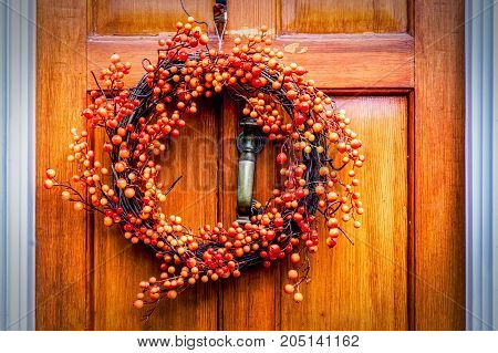 A thanksgiving wreath hanging on a door in northern Virginia.