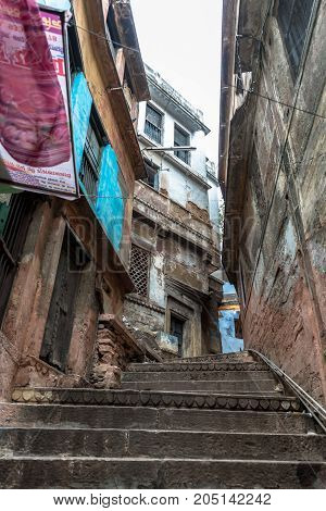 VARANASI INDIA - MARCH 13 2016: Vertical picture of stairs close to Dashashwamedh Ghat in front of Ganges River in the city of Varanasi in India