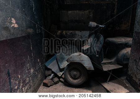 VARANASI INDIA - MARCH 13 2016: Horizontal picture of old motorcycle parked in a narrow street of Varanasi in India