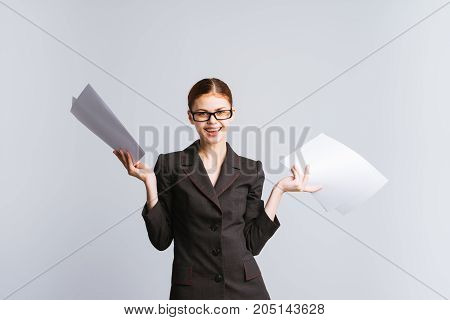 The cheerful businesswoman girl joyfully picked up the papers