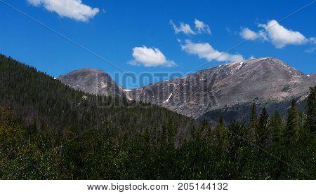 Colorado Mountain with blue cloudy sky. Alpine.