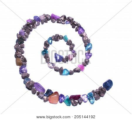 Spiral. Ornate. Separated. Symbol made from rocks.