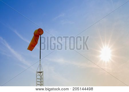 Double exposure of Windsock against on sun rise backgroundbeautiful