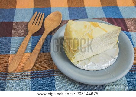 Crepe Cake  Or Milk Cake In A Plate With Wooden Spoon And Fork