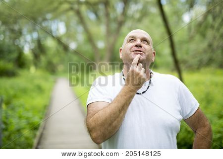 A men outdoors close to 50s in forest