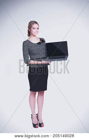 Young beautiful woman showing a laptop, isolated on white background.