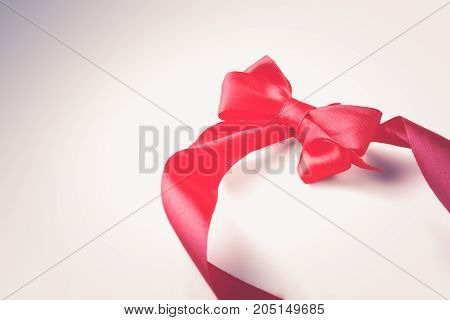 Red ribbon bow isolated on white background.