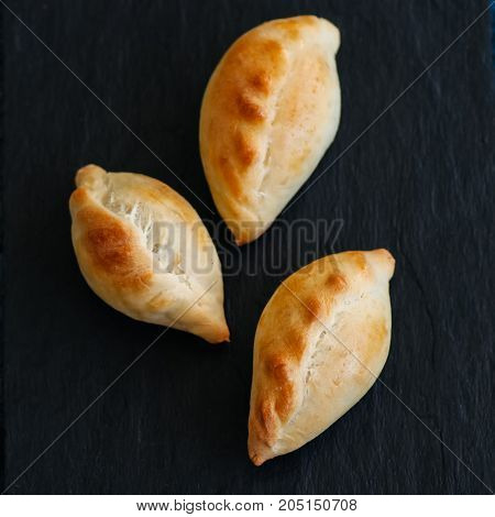 Small Mashed Potato Pasties (hand Pies) On A Slate Background. Square Image.