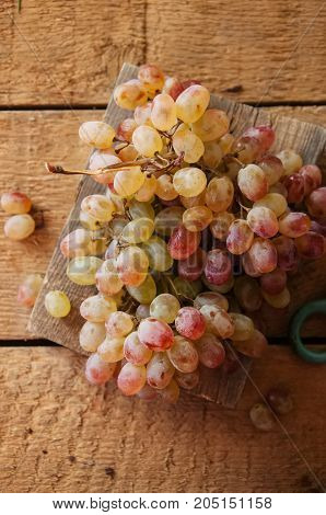 Brunch Of Fresh Ripe Grape On A Wooden Background. Close Up And Top View.
