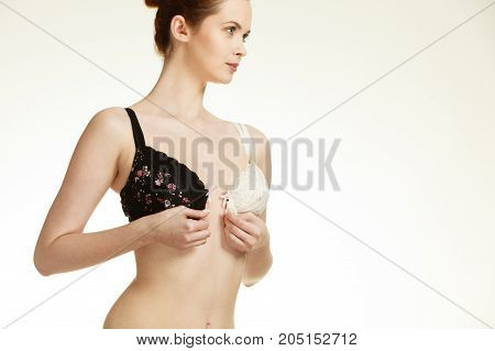Girl Of Smooth Body With Brassiere Dilemma.