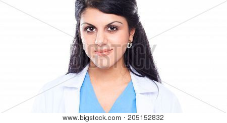Young doctor woman with stethoscope standing near wall