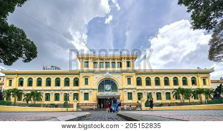 Ho Chi Minh City, Vietnam - September 15th, 2017: Tourists visit outside Saigon Central Post Office Architecture. It was built by the French in 1886 and is a popular attraction in Ho Chi Minh City, Vietnam.