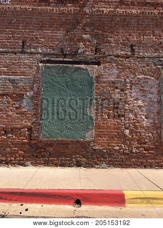 Brick wall and blocked windows of historic building in Phoenix downtown Arizona