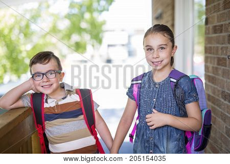 Two cute kids brother sister go to school