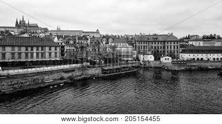 PRAGUE CZECH REPUBLIC - FEBRUARY 02 2014: View of old Prague and St. Vitus Cathedral. Black and White. Stylized film. Large grains