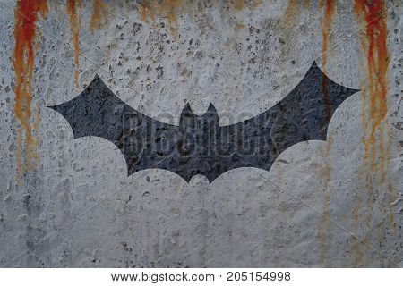 Bloody wall with bat silhouette. Halloween poster concept and greeting card template.