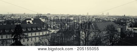 PRAGUE CZECH REPUBLIC - FEBRUARY 02 2014: Panoramic view of the rooftops of old Prague. Sepia. Stylized film. Large grains. Prague is the capital and largest city of the Czech Republic