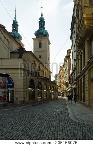 PRAGUE CZECH REPUBLIC - FEBRUARY 03 2014: The old streets in the historic center of the Old Town of the Prague. In the background the Church St. Gallus (Havel)