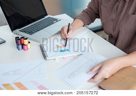 Attractive Young Woman Fashion Designer Standing And Working In Studio