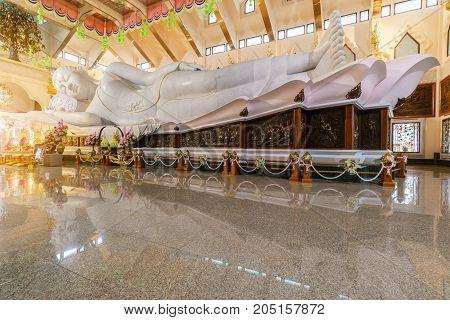 Udon Thani , Thailand - September 16 , 2017 : The biggest white Italian marble reclining Buddha Wat Pa Phu Kon temple
